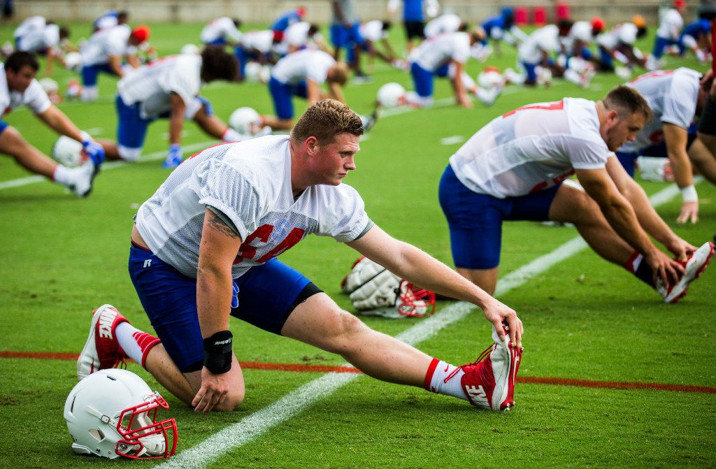 Offensive lineman Bryce Wilds (64) stretches during SMU's first football practice of the season on Tuesday, August 1 , 2017 at the SMU practice fields in Dallas.  (Ashley Landis/The Dallas Morning News)