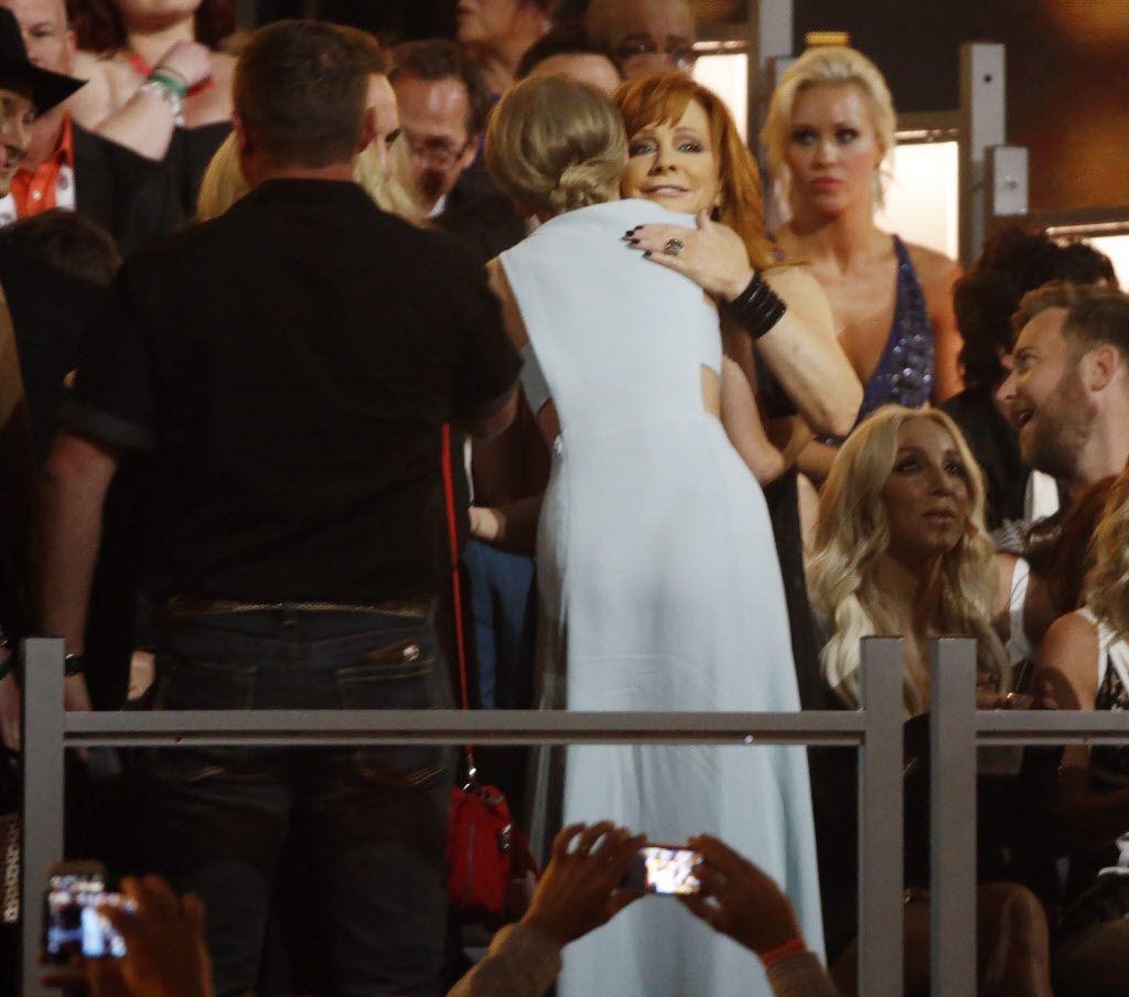 Reba McEntire (right) hugs Taylor Swift during the 2015 Academy of County Music Awards Sunday, April 19, 2015 at AT&T Stadium in Arlington, Texas.