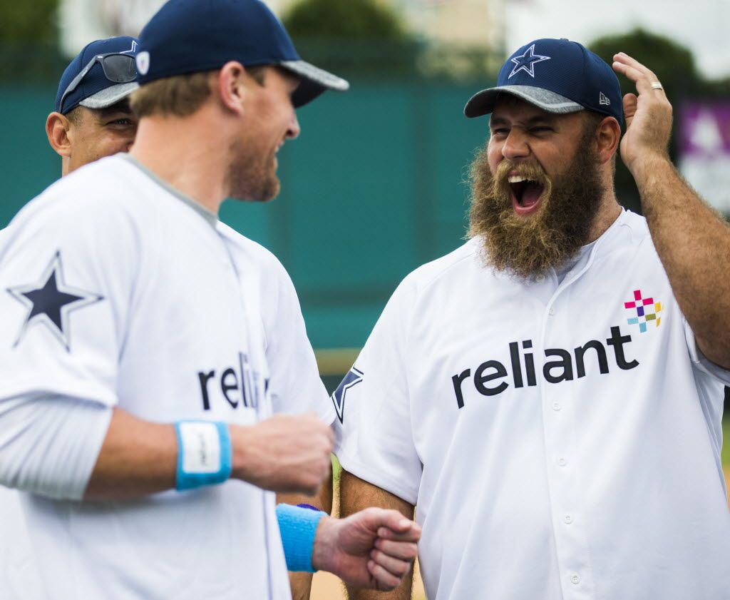 FILE - Dallas Cowboys tight end Jason Witten (82) jokes with center Travis Frederick (72) after their annual Home Run Derby contest on Tuesday, May 17, 2016 at Dr. Pepper Ballpark in Frisco, Texas. Proceeds benefit The Salvation Army Greater Metroplex Command. (Ashley Landis/The Dallas Morning News)