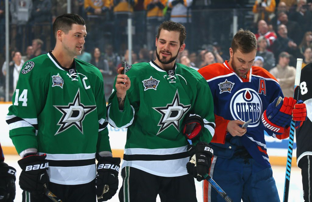 NASHVILLE, TN - JANUARY 30:  Tyler Seguin #91 of the Dallas Stars (C) takes a picture as Jamie Benn #14 of the Dallas Stars looks on during the 2016 Honda NHL All-Star Skill Competition at Bridgestone Arena on January 30, 2016 in Nashville, Tennessee.  (Photo by Bruce Bennett/Getty Images)
