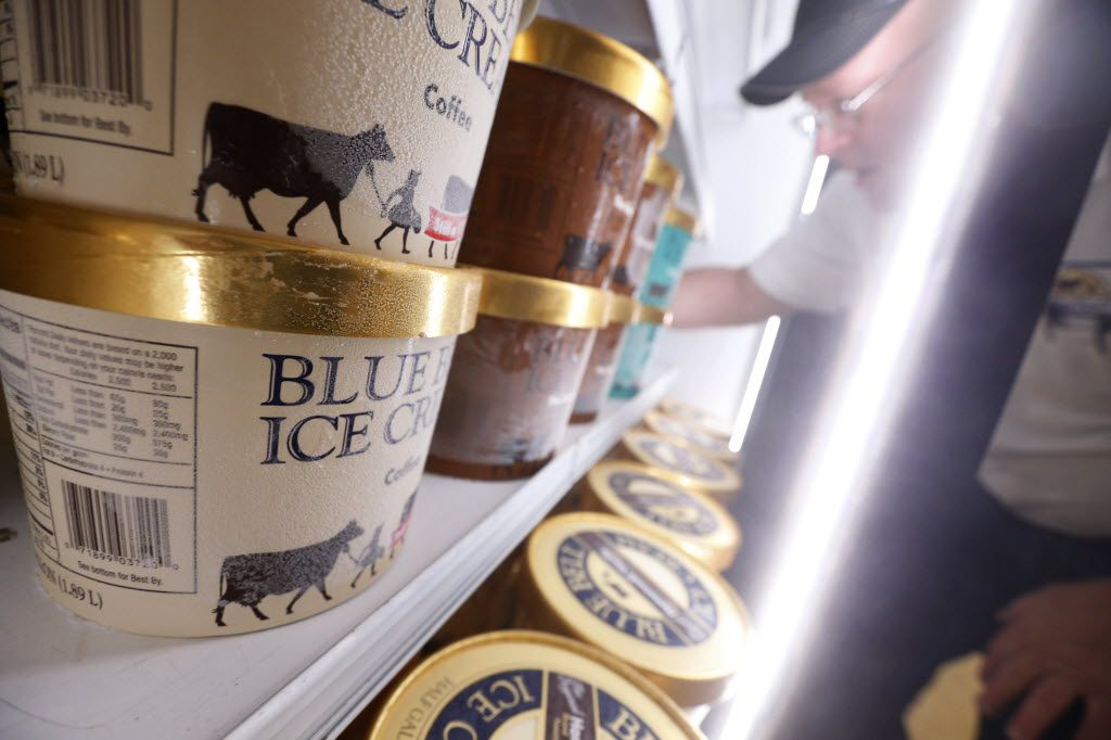 Robert Horton, route supervisor for Blue Bell Ice Cream, fills the refrigerated ice cream display at Tom Thumb in Dallas, TX  June 14, 2016.  (Nathan Hunsinger/The Dallas Morning News)