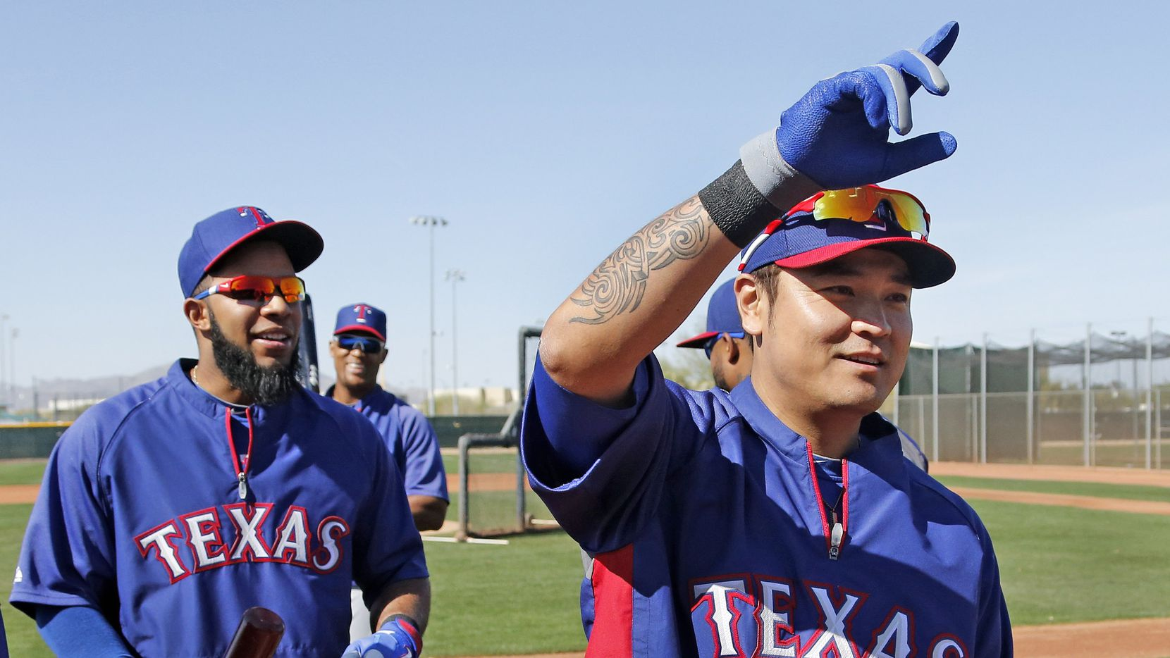 Texas shortstop Elvis Andrus, left, and outfielder Shin-Soo Choo are pictured during Texas Rangers baseball spring training in Surprise, AZ  on Thursday, February 20, 2014.