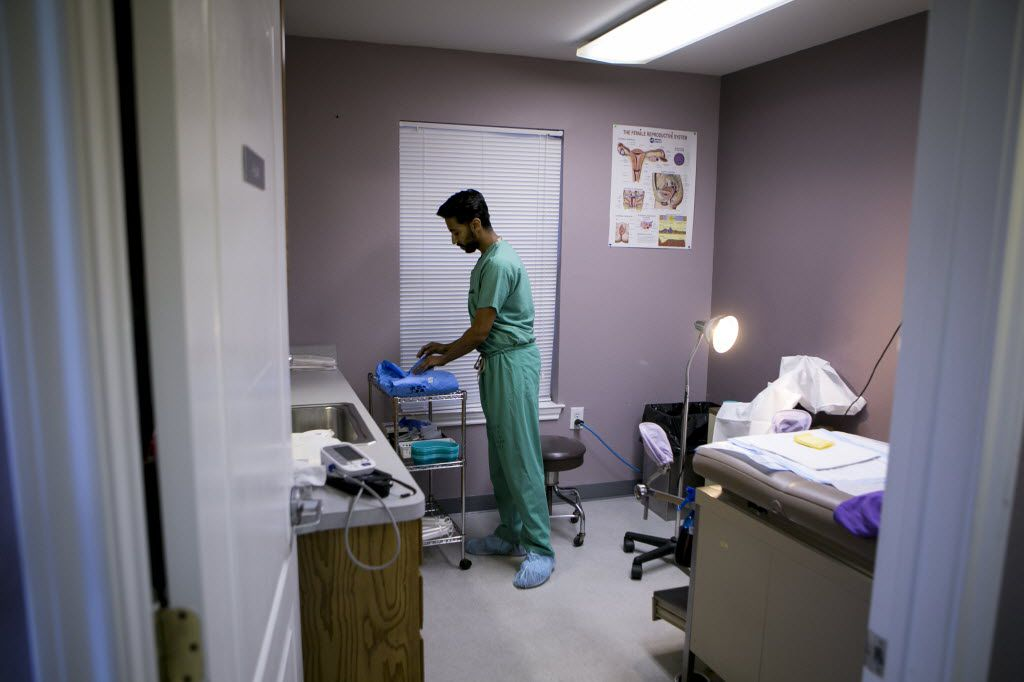 Dr. Bhavik Kumar prepares a procedure room for a patient at Whole Woman's Health clinic in Fort Worth, Texas, Feb. 20, 2016. (Ilana Panich-Linsman/The New York Times)