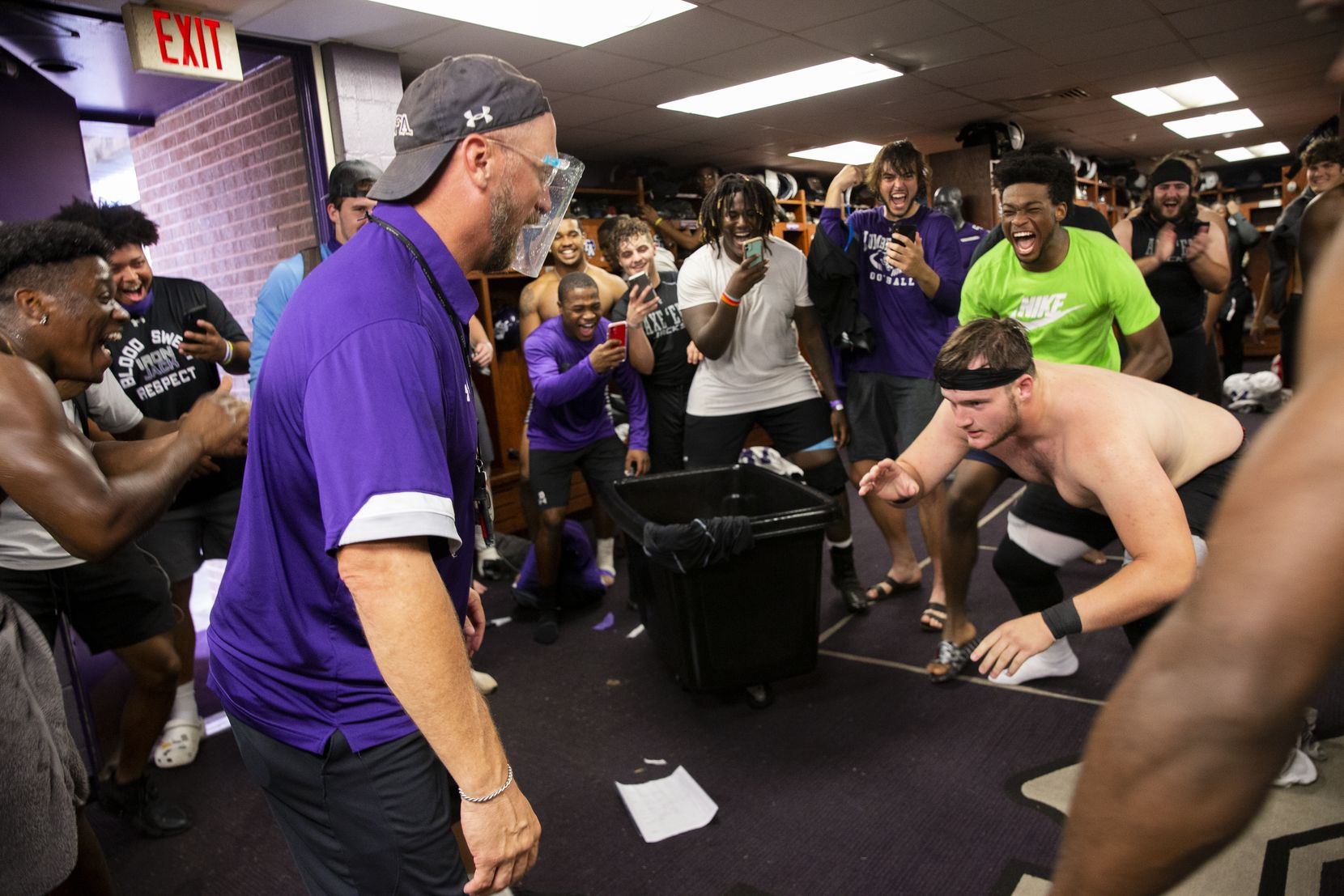 Stephen F. Austin Lumberjacks players cheer on as coach Colby Carthel jokes about wrestling offensive lineman Frank Thompson (57) in the locker room after practice in Nacogdoches on Thursday, Oct. 8, 2020 . (Juan Figueroa/ The Dallas Morning News)