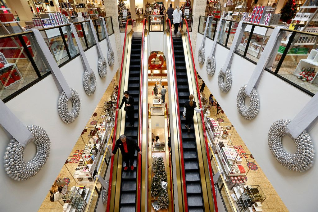 Shoppers ride an escalator at Neiman Marcus in NorthPark Center in Dallas on Nov. 23, 2018.