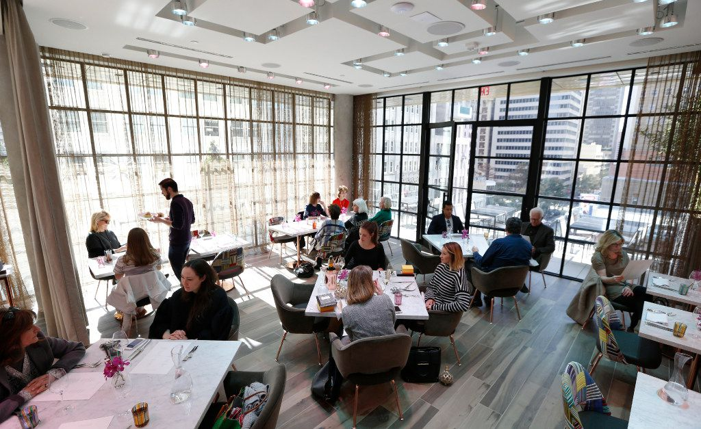 Where fashion sits: Mirador's dining room at lunchtime. The floor-to-ceiling windows look past a wraparound terrace to spectacular downtown views. L (Nathan Hunsinger/The Dallas Morning News)