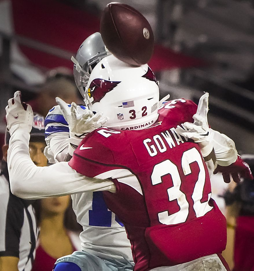 A pass intended for Dallas Cowboys wide receiver Aaron Parker (18) bounces off the helmet of Arizona Cardinals cornerback Tay Gowan (32) during the second half of a preseason NFL football game at State Farm Stadium on Friday, Aug. 13, 2021, in Glendale, Ariz.