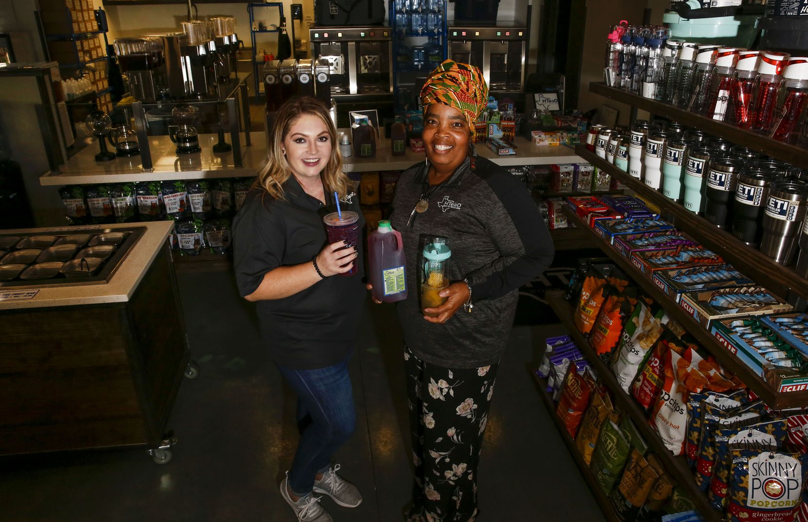 Franchise owner/operator Sasha Smithhart, left, and HTeaO Brand Ambassador Darlene Roe at the Carrollton shop, which opened in November 2019.
