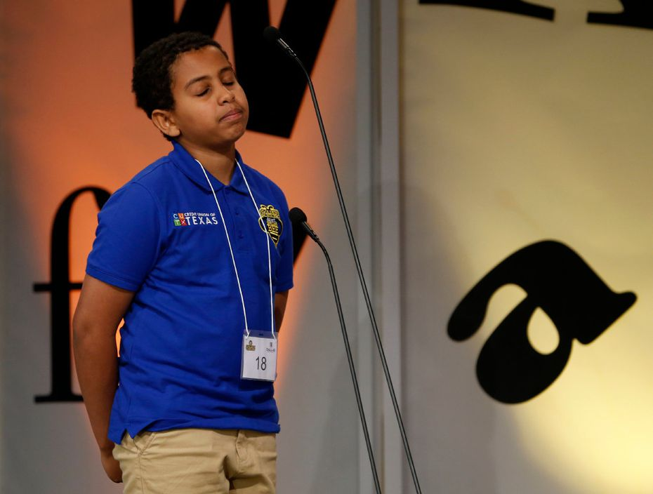 "Mena Eyob closes his eyes after misspelling ""erbium"" Saturday at the Dallas Regional Spelling Bee."