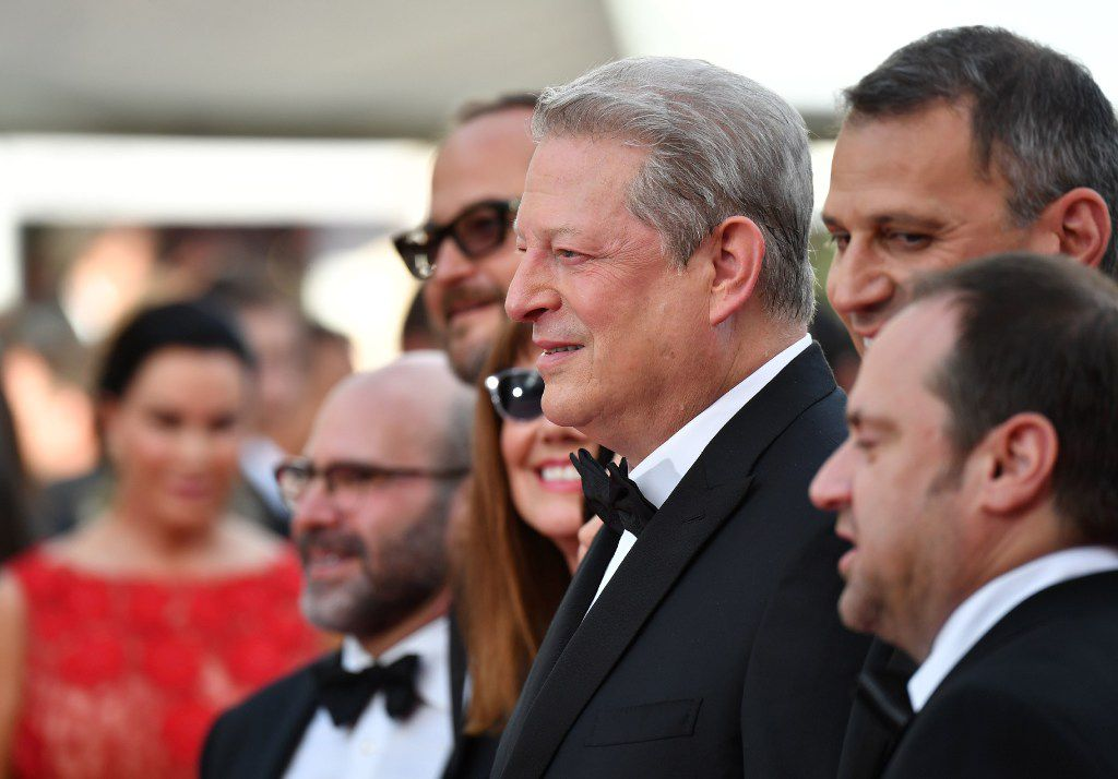 Former US vice president Al Gore (C) poses as he arrives on May 22, 2017 for the screening of the film 'An Inconvenient Sequel : Truth to Power' at the 70th edition of the Cannes Film Festival in Cannes, southern France.  / AFP PHOTO / Alberto PIZZOLIALBERTO PIZZOLI/AFP/Getty Images