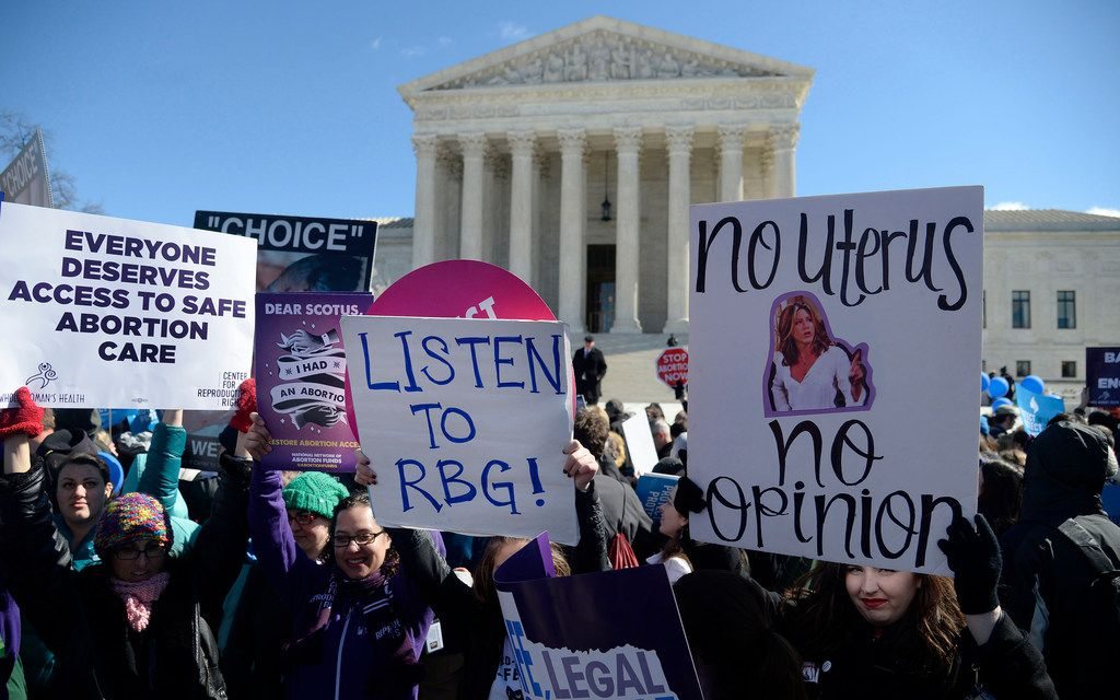 Supporters of legal access to abortion, as well as anti-abortion activists, rally outside the Supreme Court on March 2, 2016, in Washington, D.C.