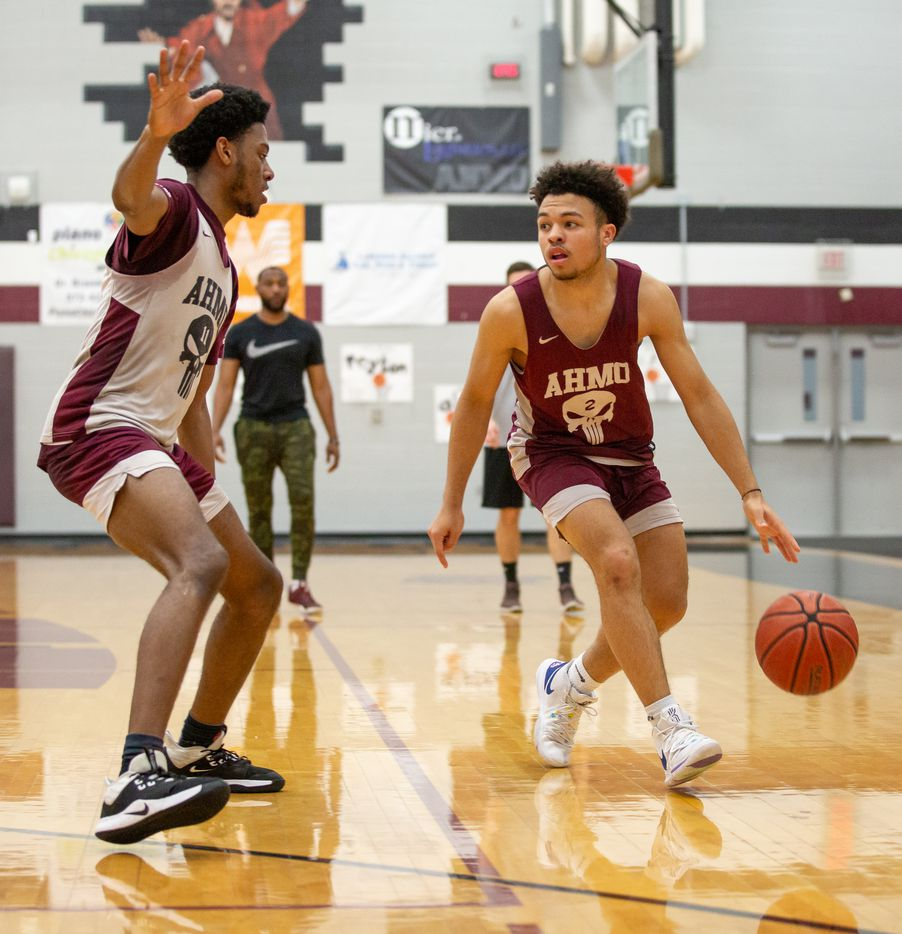 Wylie High School guard Kobe Wiggins (2) tries to dribble around his teammate during practice at Wylie High School on March 11, 2020 in Wylie, Texas. (Kara Dry/Special Contributor)