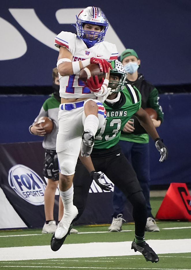 Austin Westlake defensive back Michael Taaffe (14) intercepts a pass intended for Southlake Carroll tight end RJ Maryland (13) during the second quarter of the Class 6A Division I state football championship game at AT&T Stadium on Saturday, Jan. 16, 2021, in Arlington, Texas.