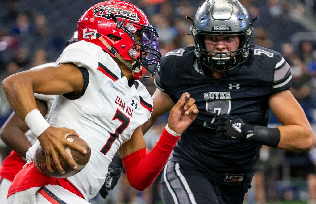 Cedar Hill quarterback Kaidon Salter (left, 7) tries to run the ball past Denton Guyer defensive lineman Cooper Lanz (7) during the Class 6A Division II area-round high school football playoff game at the AT&T Stadium in Arlington, Texas, on Saturday, November 23, 2019. (Lynda M. Gonzalez/The Dallas Morning News)