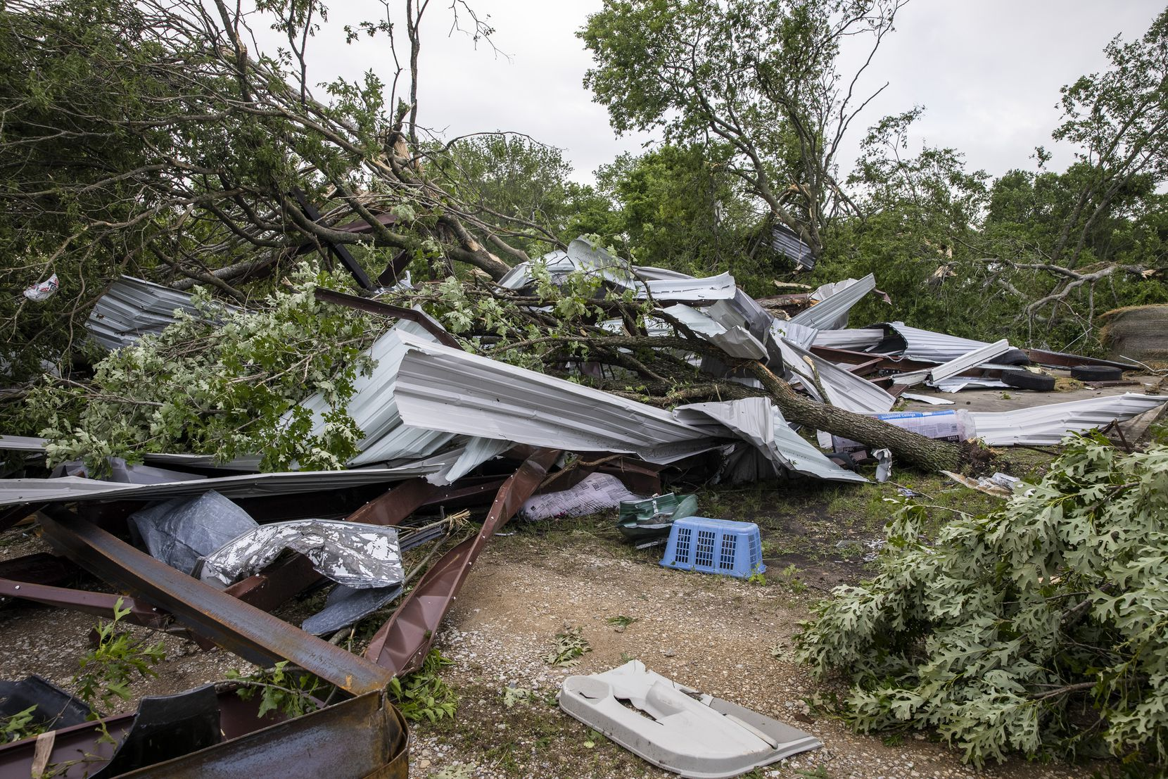 The detritus of an auto parts shop landed across the road in a neighbor's property in the aftermath of a Monday night tornado that touched down just south of Waxahachie, Texas, on Tuesday, May 4, 2021. (Lynda M. González/The Dallas Morning News)