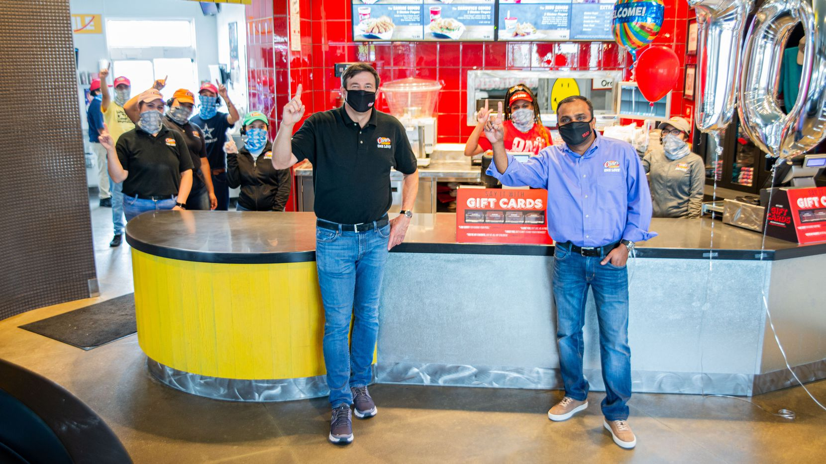 Raising Cane's Chicken Fingers co-CEOs Todd Graves, left, and AJ Kumaran are shown at one of the company's restaurants.