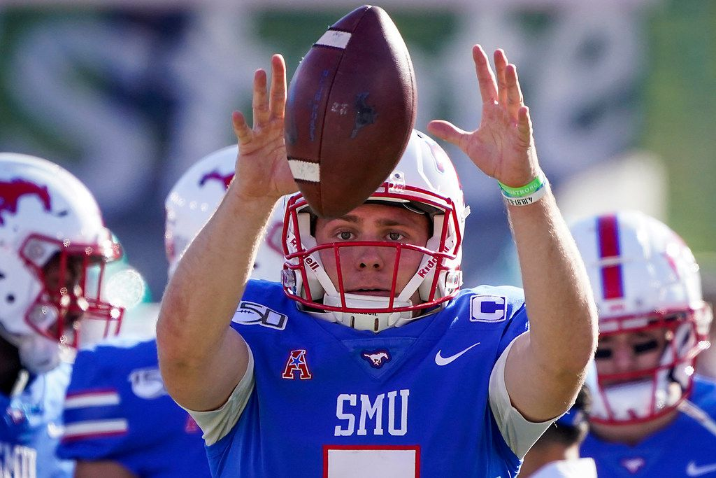 SMU quarterback Shane Buechele warms up before an NCAA football game against Tulane at Ford Stadium on Saturday, Nov. 30, 2019, in Dallas. (Smiley N. Pool/The Dallas Morning News)