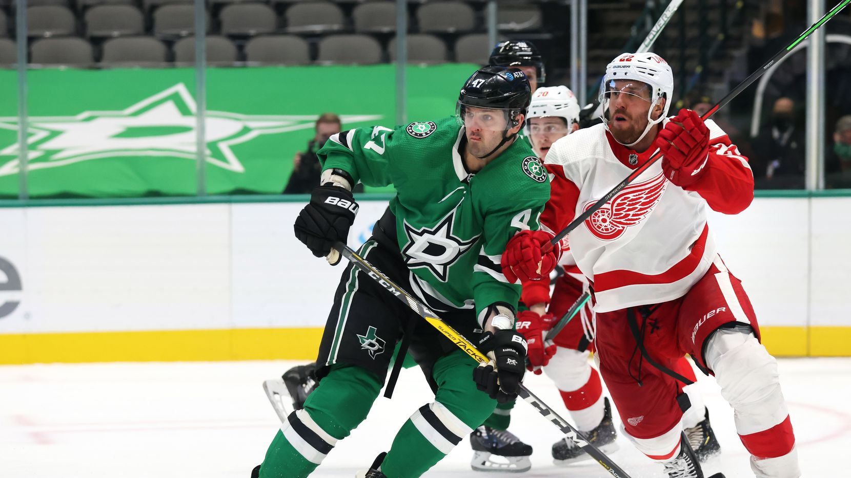 Dallas Stars right wing Alexander Radulov (47) and Detroit Red Wings defenseman Patrik Nemeth (22) fight for position during the third period of play at American Airlines Center on Tuesday, January 26, 2021 in Dallas.