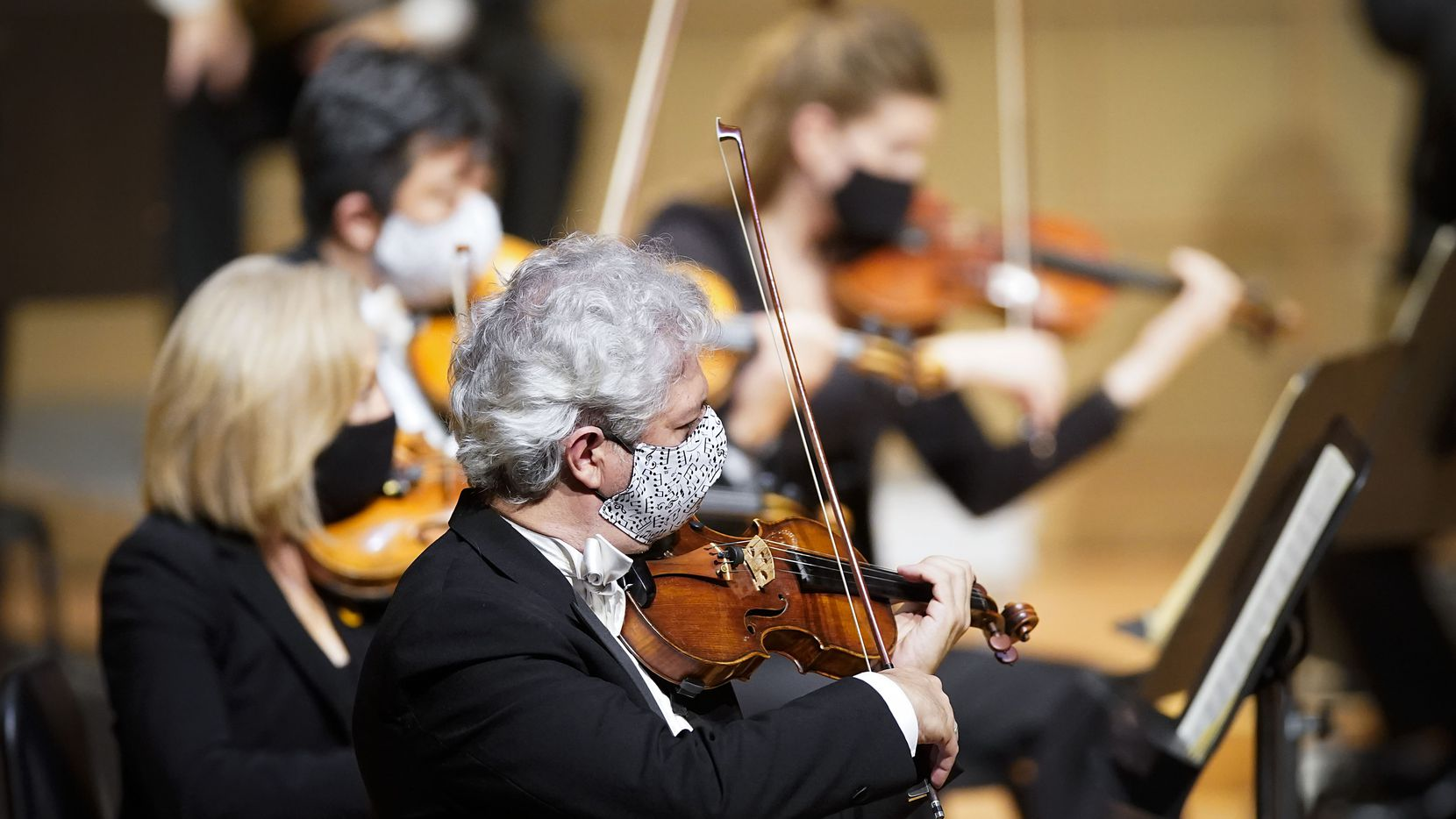 String players wear face masks as they perform during the season-opening Dallas Symphony concert at the Meyerson Symphony Center in September. Indoor venues across North Texas are beginning to resume indoor concerts during the COVID-19 pandemic, including the McKinney Performing Arts Center, which will host an indoor show this weekend.