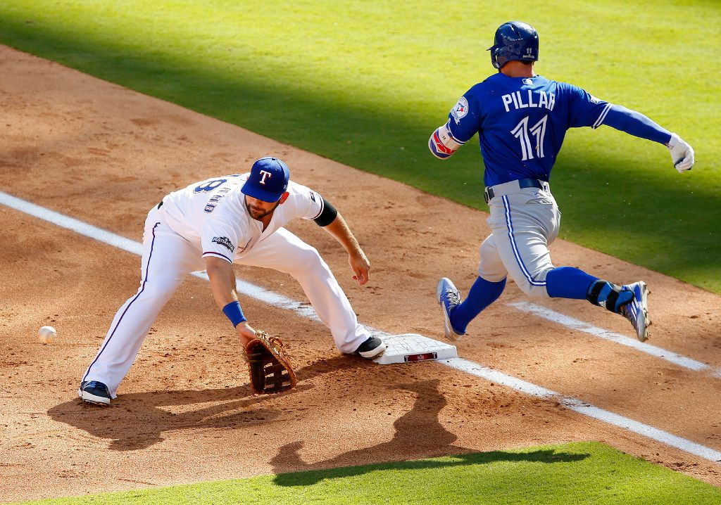 Toronto Blue Jays center fielder Kevin Pillar (11) is out at first base as Texas Rangers first baseman Mitch Moreland (18) makes the catch during the first inning of the ALDS Series Game 1 at Globe Life Park in Arlington, Thursday, October 6, 2016. Texas Rangers shortstop Elvis Andrus (1) made a spectacularr throw to get the out. (Tom Fox/The Dallas Morning News)