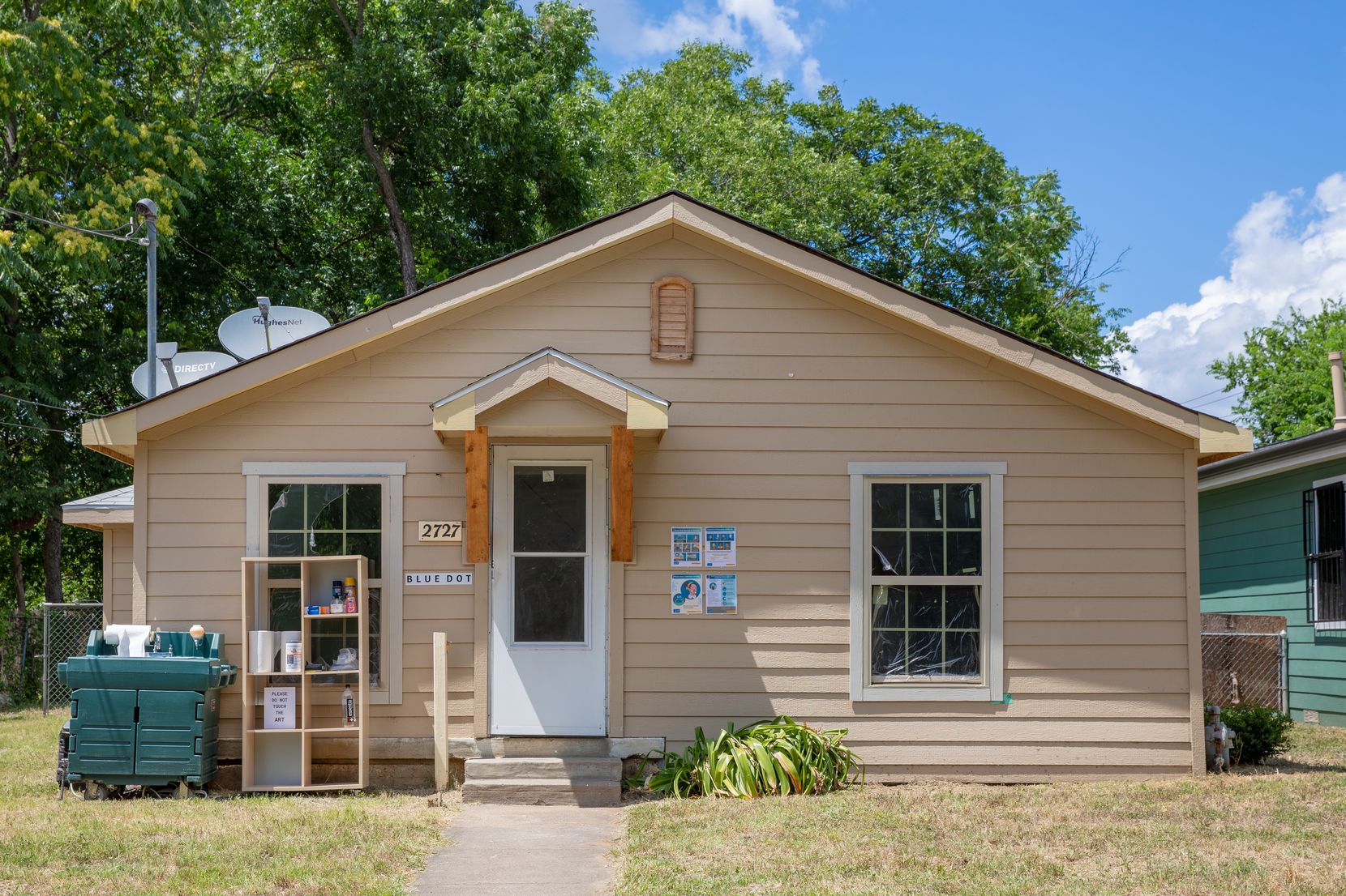 """The """"Blue Dot"""" show runs through 6 p.m. Tuesday in this house at 2727 Rochester St. in South Dallas."""