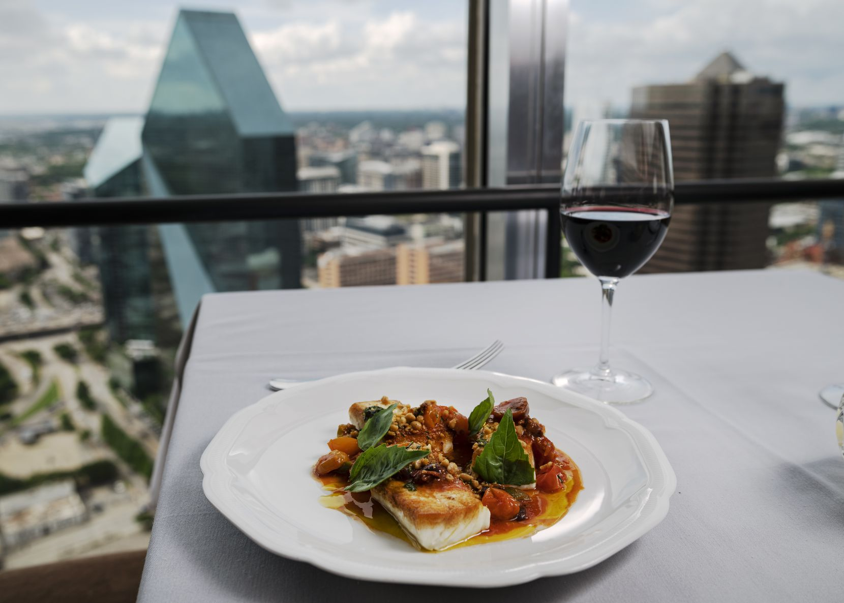 Roasted Halibut with tomato and olive sauce from Chef Eric Dreyer at Monarch restaurant in Downtown Dallas