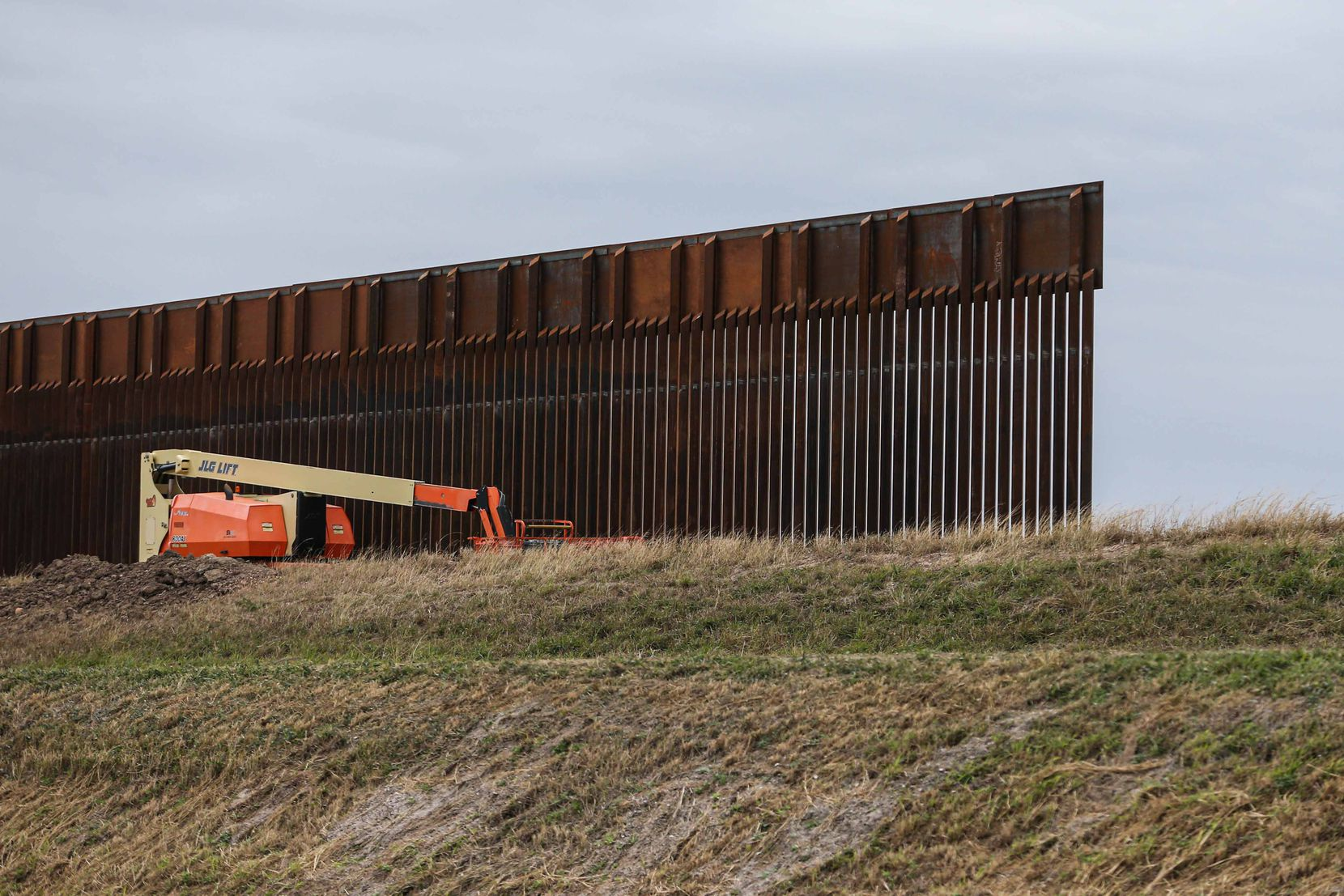 Part of the wall under construction Tuesday in Alamo near Military Highway along the border with Mexico.