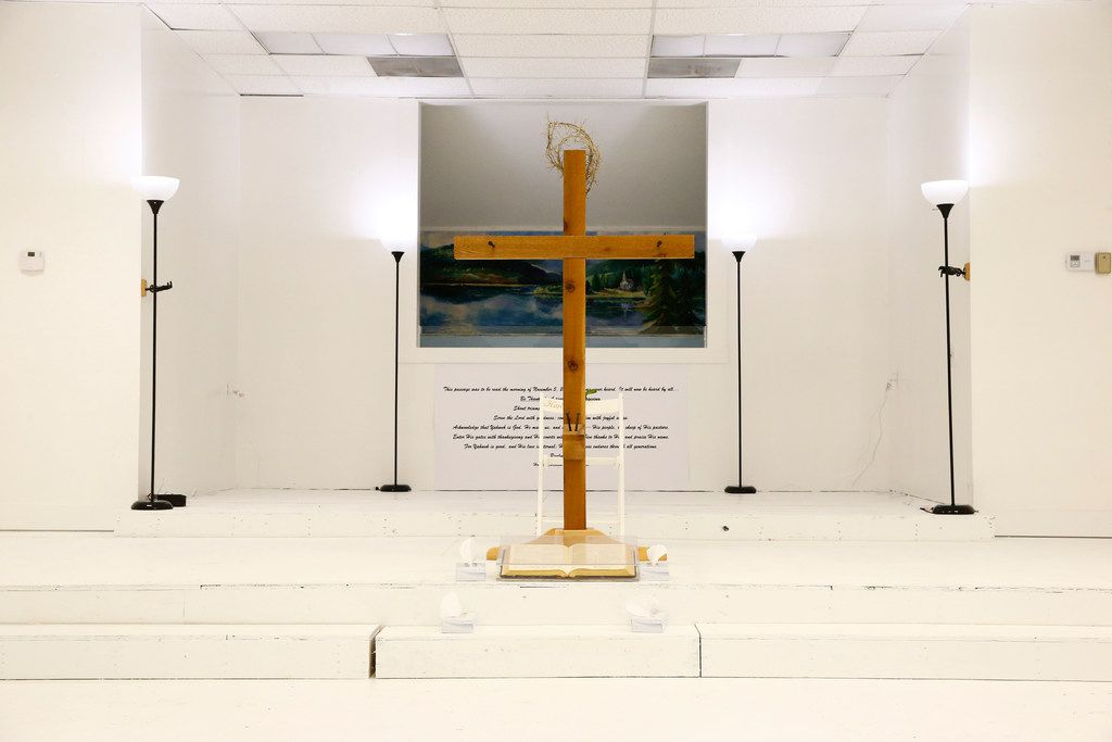 A cross sit on the stage as visitors are allowed into First Baptist Church to pay their respects a week after the shooting in Sutherland Springs on Nov. 12, 2017. The church was the site of a shooting that killed 26 and left 30 injured. (Nathan Hunsinger/The Dallas Morning News)