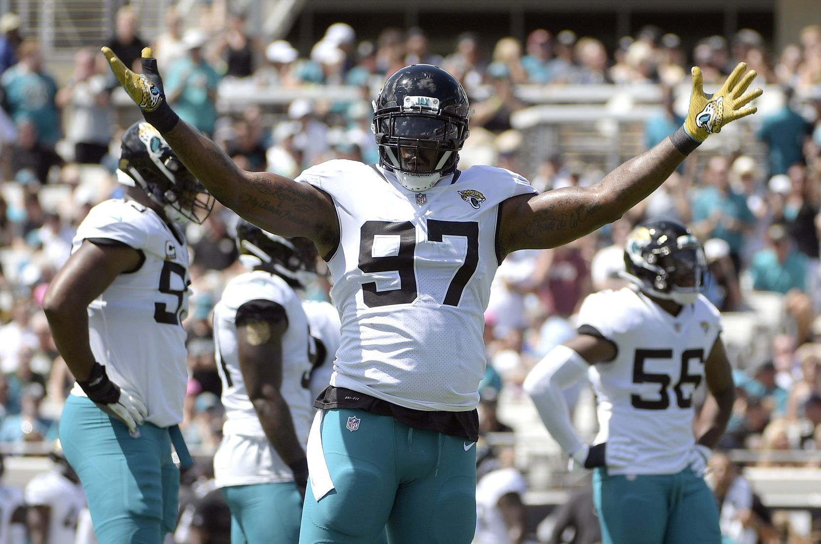 FILE - In this Sept. 23, 2018, file photo, Jacksonville Jaguars defensive tackle Malik Jackson (97) gestures during the first half of an NFL football game against the Tennessee Titans in Jacksonville, Fla. Jackson is no longer a starter and his playing time is dwindling, clear signs his tenure in Jacksonville is nearing an end. (AP Photo/Phelan M. Ebenhack)