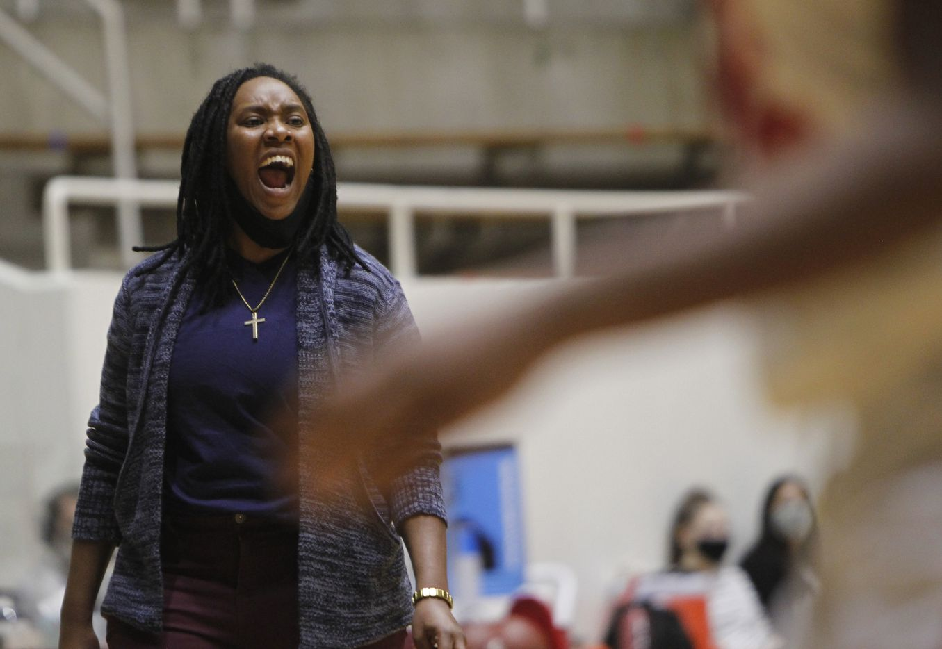 Duncanville head coach LaJeanna Howard shares some advice with her players during the first half of their game with Mesquite Horn. The two teams played their Class 6A area-round playoff basketball game at Loos Field House in Addison on February 23, 2021. (Steve Hamm/ Special Contributor)