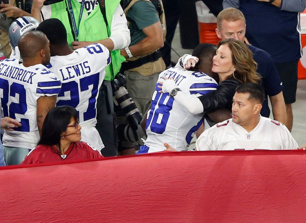 Dallas Cowboys wide receiver Dez Bryant (88) and Dallas Cowboys executive vice president Charlotte Jones hug after the National Anthem prior to the start of a game against the Arizona Cardinals at University of Phoenix Stadium in Glendale, Arizona on Monday, September 25, 2017. (Vernon Bryant/The Dallas Morning News)