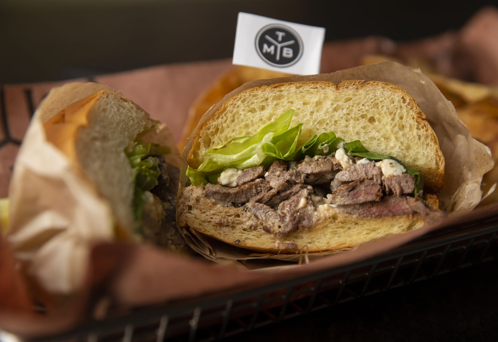 You can get the signature grilled steak sandwich at the Meat Board in Fort Worth.