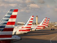 American Airlines jets are parked at Dallas-Fort Worth International Airport's Terminal C, Sunday, April 19, 2020. Airlines have pared flight schedules due to the COVID-19 pandemic. (Tom Fox/The Dallas Morning News)