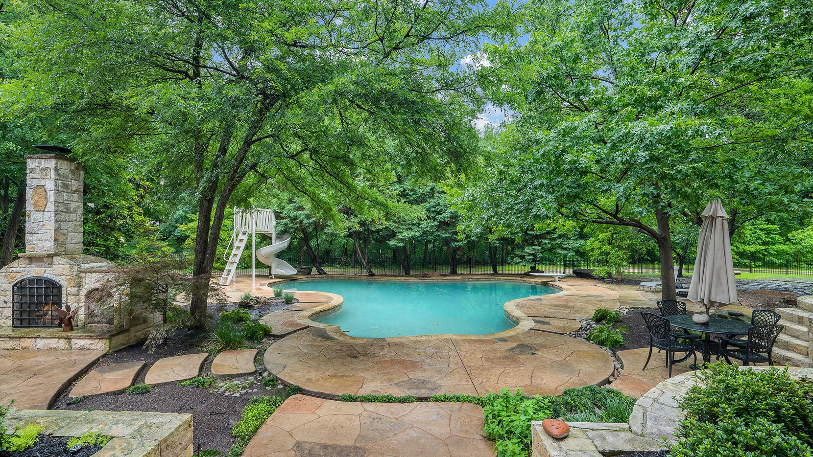 Situated on a double wooded lot, the estate at 6645 Whispering Woods Court is Plano's Shoal Creek is offered at $2,595,000. The home will be held open from 1 to 3 p.m. today.