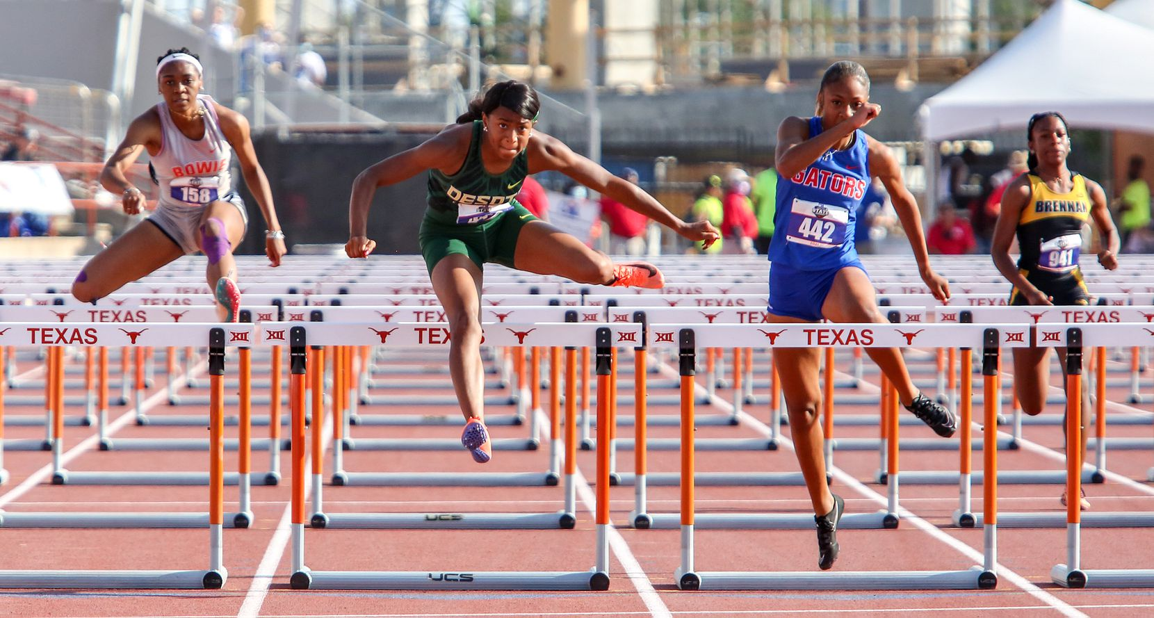 DeSoto's Jalaysi'ya Smith jumps over the last hurdle in the 6A Girls 100 meter hurdles during the UIL state track meet at the Mike A. Myers Stadium, at the University of Texas on May 8, 2021 in Austin, Texas.