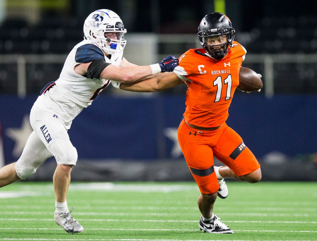 Rockwall wide receiver Jaxon Smith-Njigba (11) pushes away Allen linebacker Jaden Healy (2) during the first quarter of a Class 6A Division I area-round high school football playoff game between Allen and Rockwall on Friday, November 22, 2019 at AT&T Stadium in Arlington. (Ashley Landis/The Dallas Morning News)