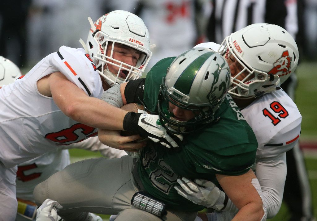 Aledo's Oliver Crow (61) Tre Owens (19) tackle Reedy's MIchael Ferrara (31) during the first half of the Class 5A Division II Region II final at Northwest ISD Stadium in Justin, Texas on Dec. 8, 2018. (Nathan Hunsinger/The Dallas Morning News)
