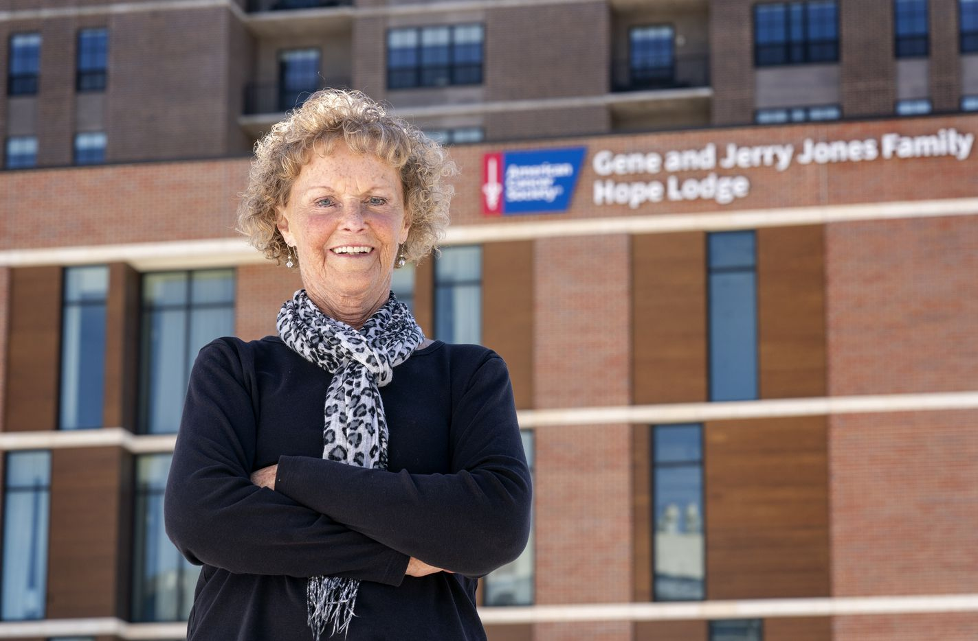Rose Riley poses for a portrait outside Hope Lodge. She drives from Oklahoma for treatment at UT Southwestern and was the first person to stay at the new facility in Deep Ellum.