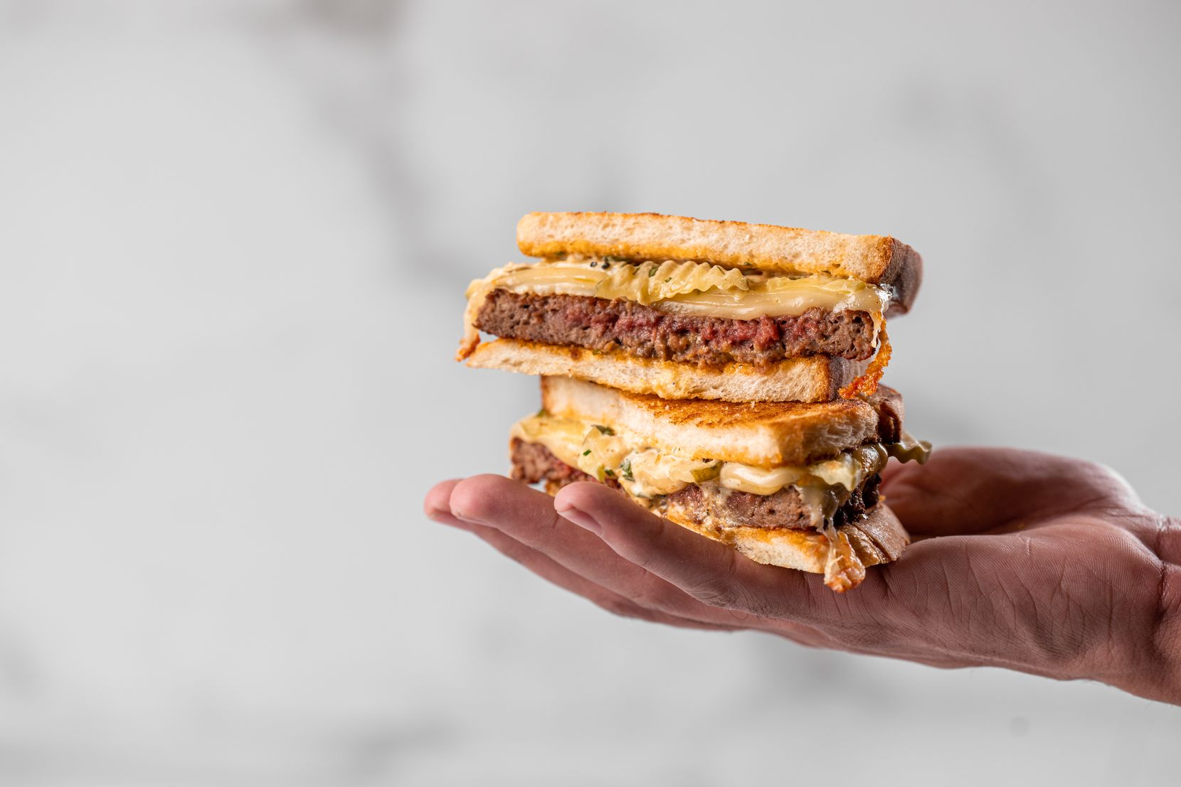 The patty melt at Rise & Thyme in the AT&T Discovery District in downtown Dallas is made with a plant-based Impossible Foods patty.