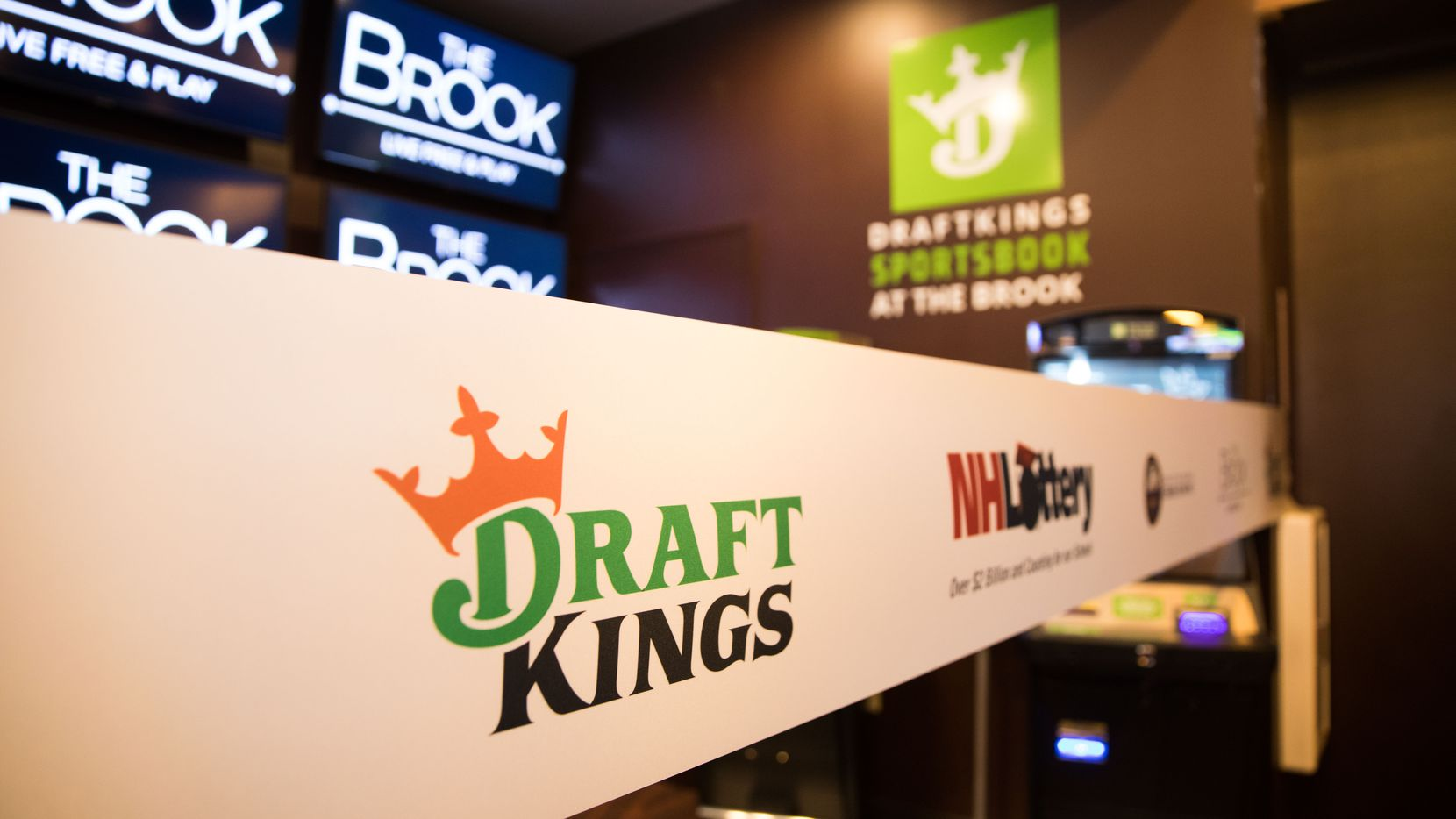 Signage at the DraftKings Sportsbook at The Brook ribbon cutting on October 23, 2020 in Seabrook, New Hampshire. A coalition of pro teams and mobile sports betting platforms want to legalize similar wagering in Texas. (Scott Eisen/Getty Images for DraftKings/TNS)