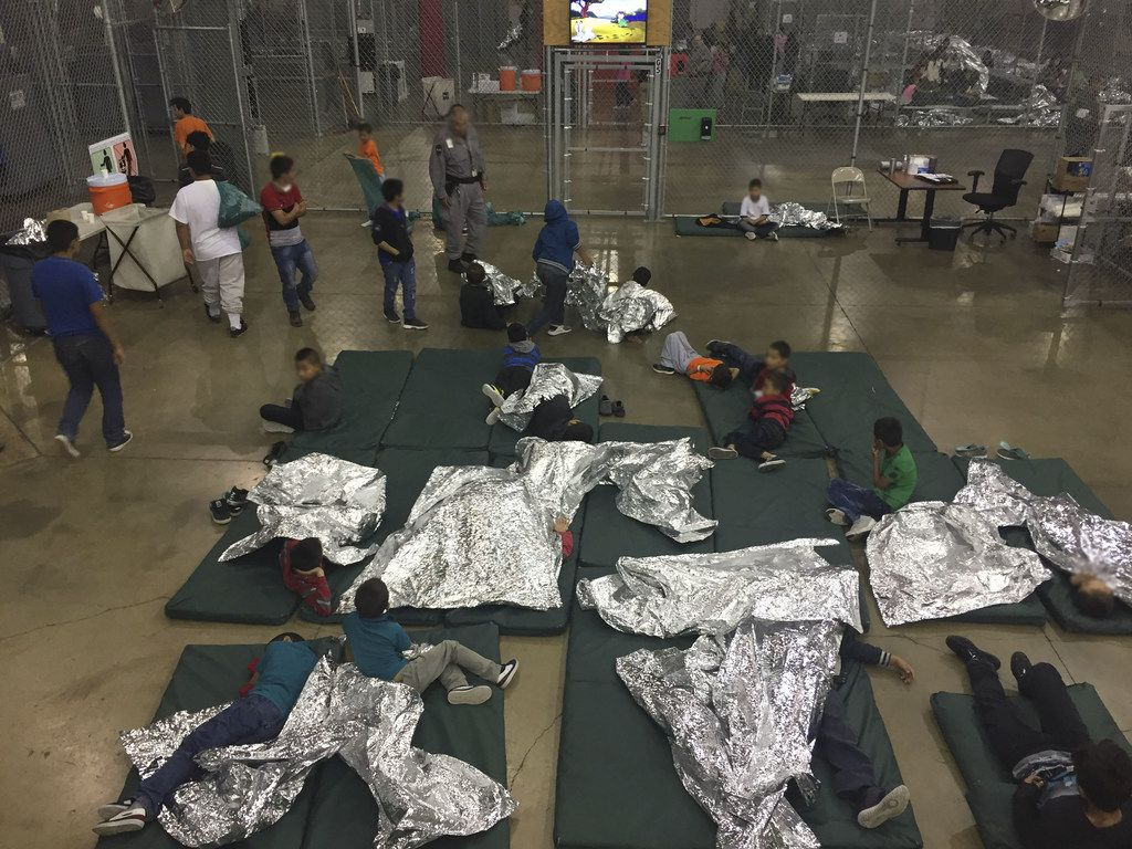 A U.S. Customs and Border Protection photo shows intake of unauthorized immigrant children by Border Patrol agents at the Central Processing Center in McAllen.