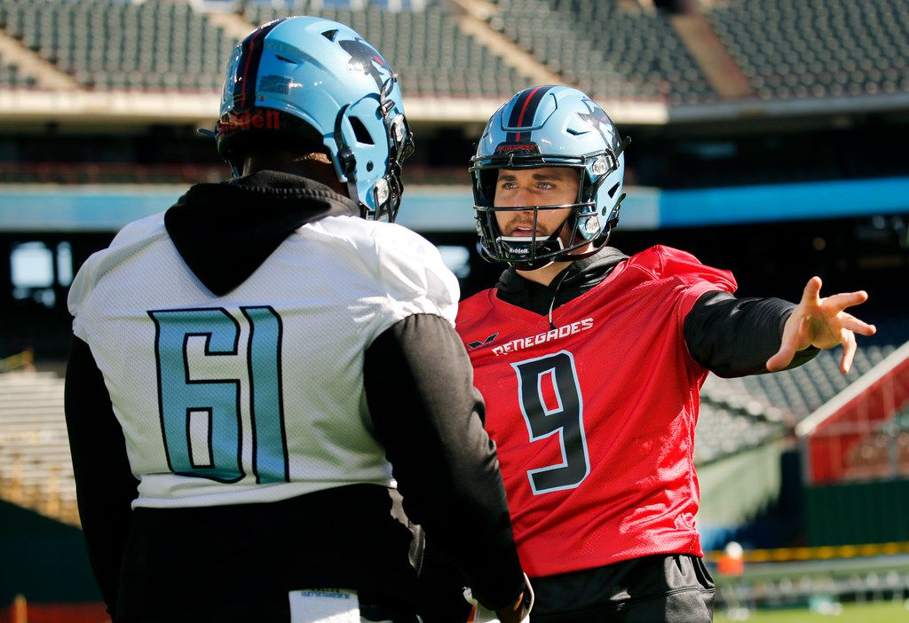 Dallas Renegades quarterback Philip Nelson (9) visits offensive guard Maurquice Shakir (61) during the teams practice before fans on the newly constructed football field at Globe Life Park in Arlington, Texas, Saturday, February 1, 2020. Nelson may start if Landry Jones hasn't fully recovered from an injury. Their season starts February 9.
