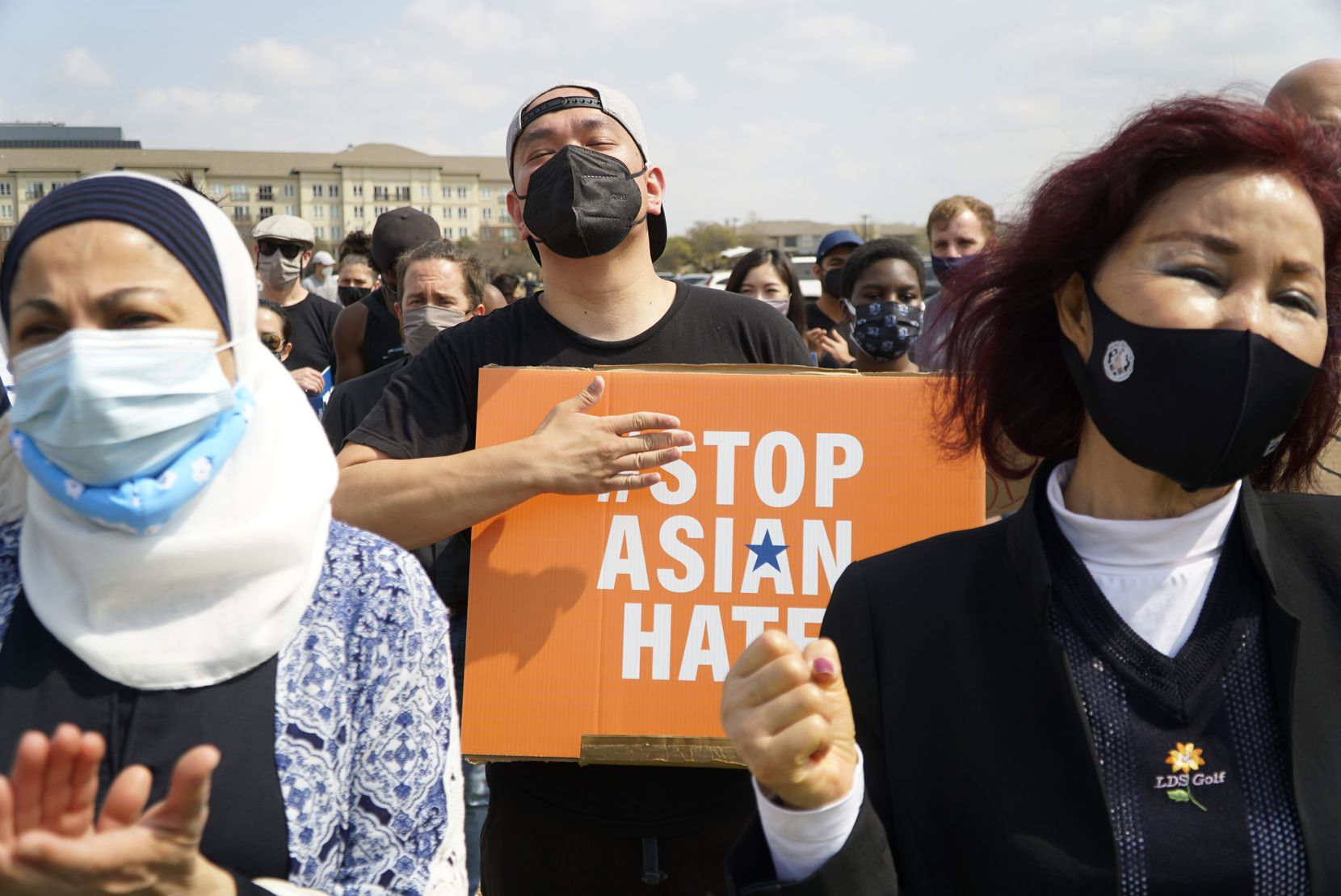 Sabina Ibraheem (from left), Mark Quach, and Kilja Park took part in a Stop Asian Hate rally in Dallas on March 27, 2021.