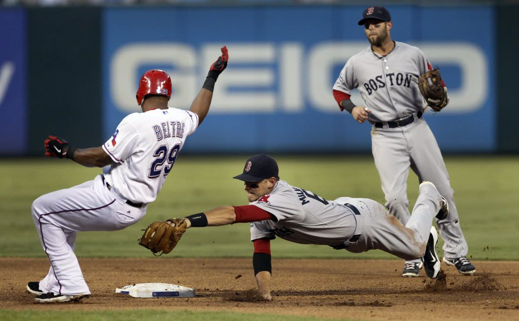 FILE - Adrian Beltre avoids the tag by Boston's Will Middlebrooks on a double in the bottom of the fourth inning of a game at the Ballpark in Arlington on Tuesday, July 24, 2012.  (Louis DeLuca/The Dallas Morning News)