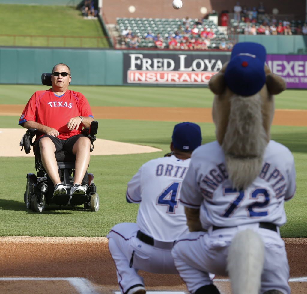 Tracy Beard threw out the ceremonial first pitch before the Texas Rangers-Los Angeles Angels game in Arlington on July 5, 2015. (Michael Ainsworth/The Dallas Morning News)