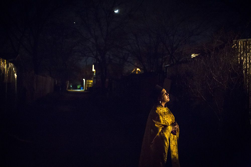 Alia Tavokolian, who plays Friar Francis, watches from the alley behind the bar as she awaits her cue to enter a scene.