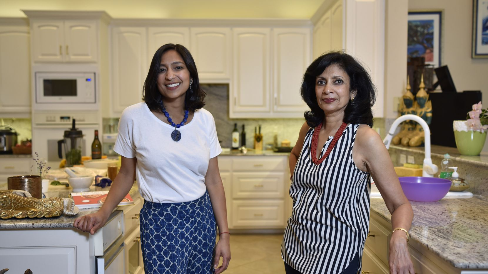Food writer and Dallas native Priya Krishna, left, announced on Aug. 6, 2020 she will no longer contribute to the company's popular YouTube videos because of unequal pay. She's pictured here in 2019 with her mother Ritu Krishna at their family home in Dallas.