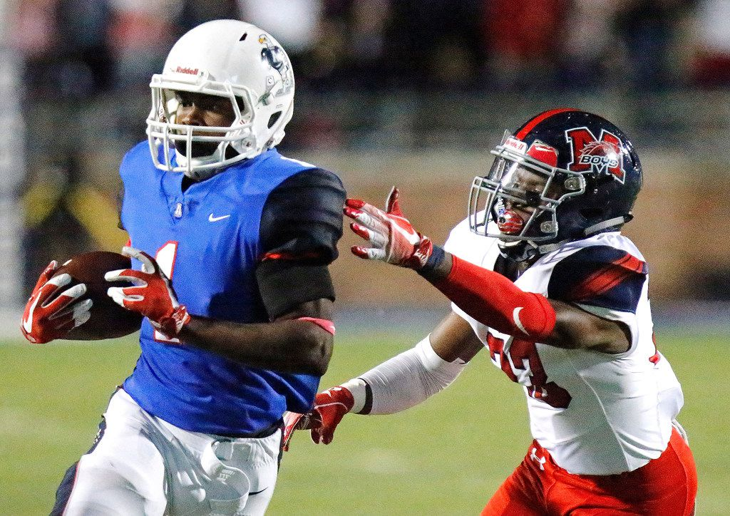 Allen High School running back Celdon Manning (1) is caught by McKinney Boyd High School defensive back Nate Jackson (23) during the first half as Allen High School hosted McKinney Boyd High School at Eagle Stadium in Allen on Friday night, October 26, 2018.  (Stewart F. House/Special Contributor)