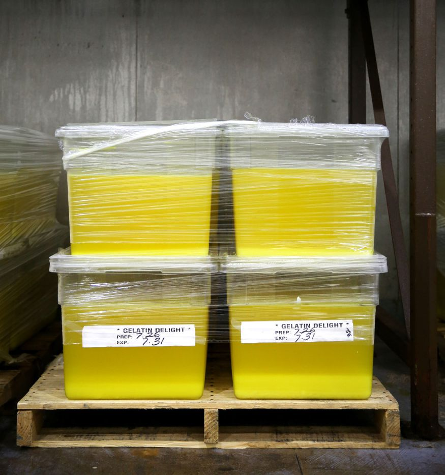 Tubs of lemon gelatin, to be dished out to the inmates, sit inside a cooler.