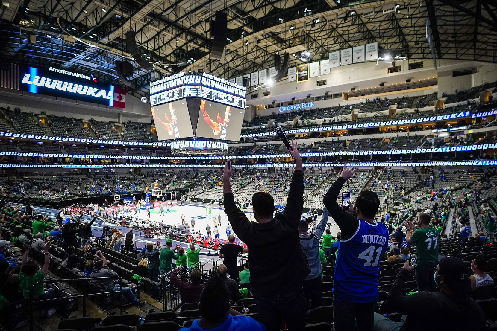 Dallas Mavericks fans celebrate a basket by guard Luka Doncic during the second half of a victory over the LA Clippers in an NBA basketball game at American Airlines Center on Wednesday, March 17, 2021, in Dallas.